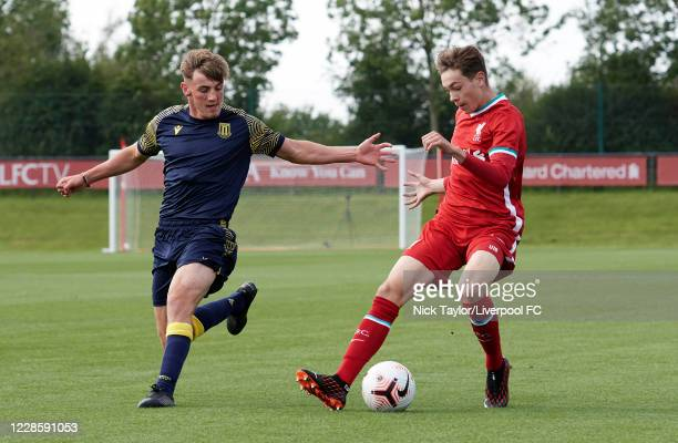 Luke Chambers of Liverpool and Tom Nixon of Stoke City in action during the U18 Premier League game at The Kirkby Academy on September 19 2020 in...