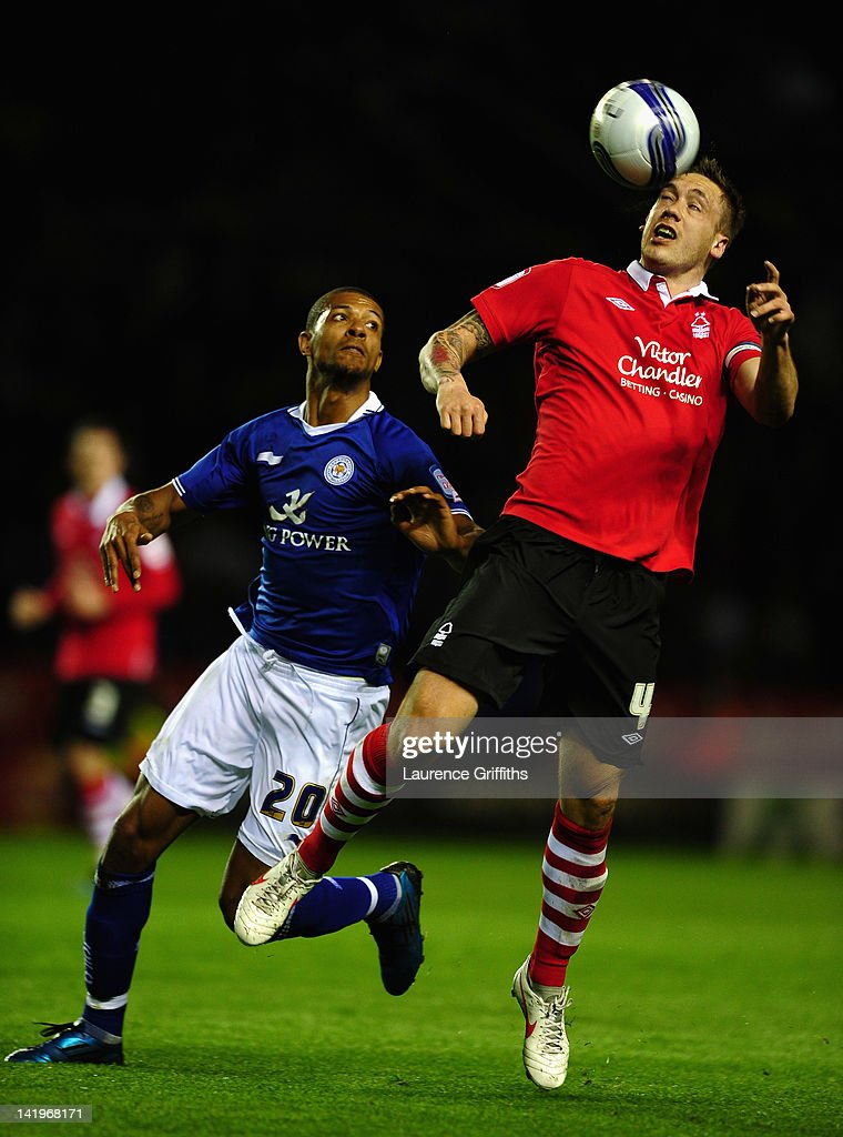 Luke Chambers of Nottingham Forest battles with Jermaine Beckford of Leicester City during the npower championship match between Leicester City and Nottingham Forest at The King Power Stadium on March 27, 2012 in Leicester, England.