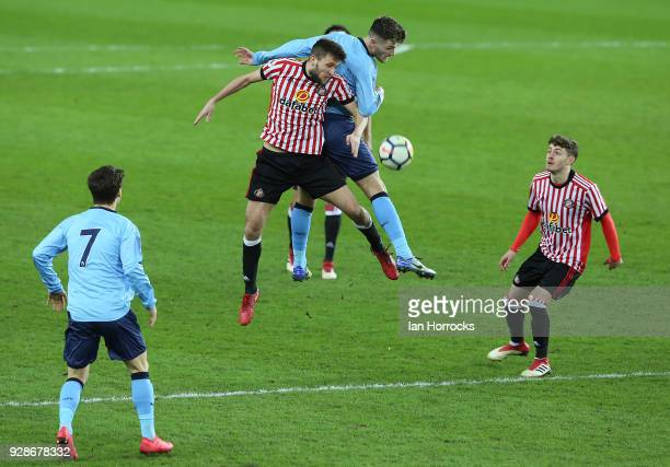 Luke Chapman of Newcastle in an ariel battle with Joshua Robson of Sunderland during the Premier League International Cup match between Sunderland...