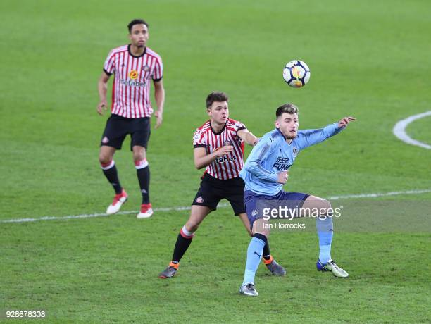 Luke Chapman of Newcastle is marked by Brandon Taylor of Sunderland during the Premier League International Cup match between Sunderland U23 and...