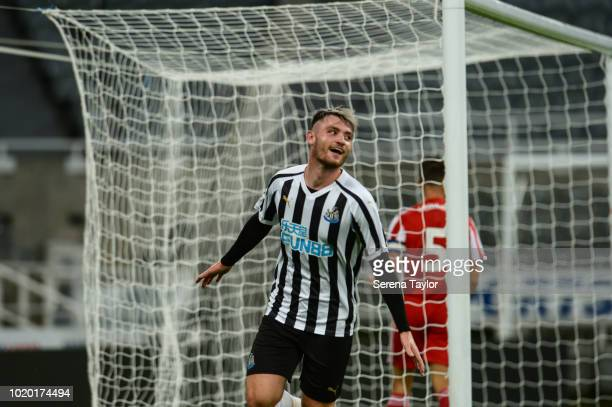 Luke Charman of Newcastle United celebrates after he scores Newcastle's third goal during the Premier League 2 Match between Newcastle United and...