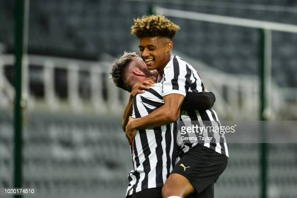 Luke Charman of Newcastle United celebrates with teammate Adam Wilson after he scores Newcastle's third goal during the Premier League 2 Match...
