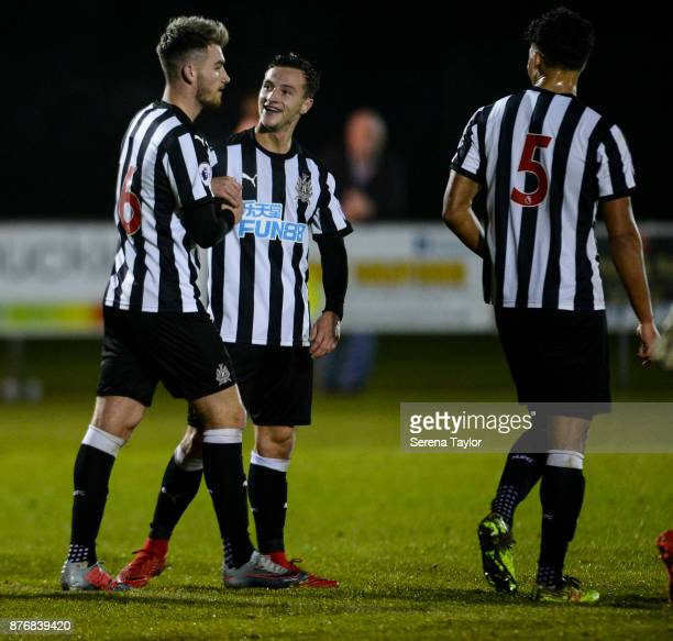 Luke Charman of Newcastle United celebrates with teammate Jamie Sterry after he scores his second and Newcastle's fourth goal during the Premier...