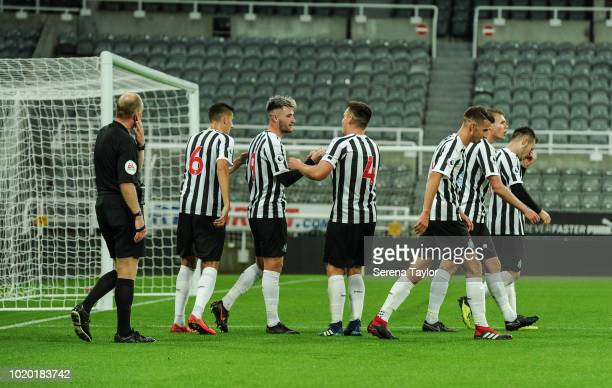 Luke Charman of Newcastle United celebrates with teammates after he scores Newcastle's fourth goal during the Premier League 2 Match between...