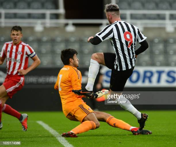 Luke Charman of Newcastle United scores Newcastle's third goal past Sunderland Goalkeeper Max Johnstone during the Premier League 2 Match between...