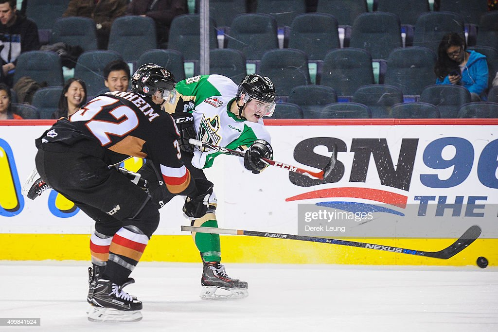 Luke Coleman #28 of the Prince Albert Raiders takes a shot before Travis Sanheim #32 of the Calgary Hitmen can check him during a WHL game at Scotiabank Saddledome on December 3, 2015 in Calgary, Alberta, Canada.