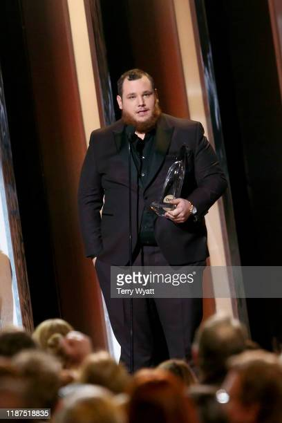 Luke Combs accepts an award onstage during the 53rd annual CMA Awards at the Bridgestone Arena on November 13 2019 in Nashville Tennessee