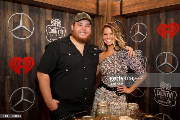 Luke Combs and Amy of Bobby Bones Show are seen backstage at the 2019 iHeartCountry Festival Presented by Capital One at the Frank Erwin Center on...