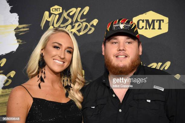 Luke Combs and Nicole Hocking attend the 2018 CMT Music Awards at Bridgestone Arena on June 6 2018 in Nashville Tennessee