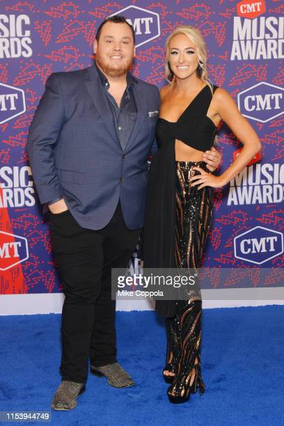 Luke Combs and Nicole Hocking attend the 2019 CMT Music Award at Bridgestone Arena on June 05 2019 in Nashville Tennessee