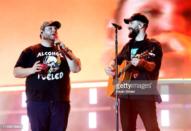 Luke Combs and Sam Hunt perform onstage during the 2019 Stagecoach Festival at Empire Polo Field on April 27 2019 in Indio California