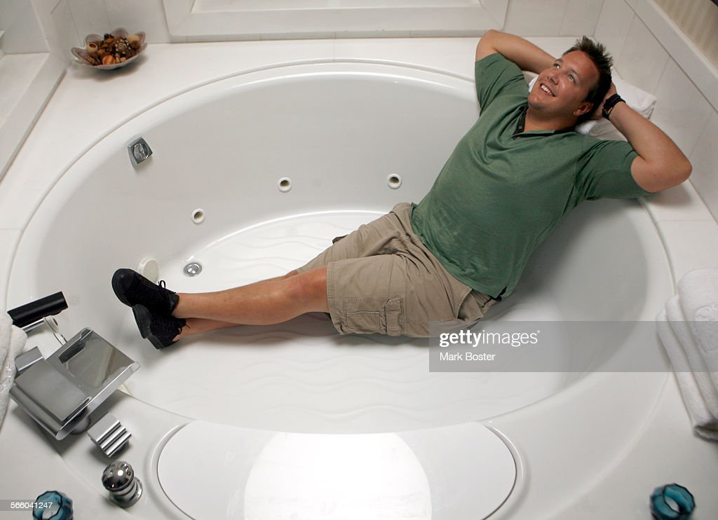 Luke Conley stretches out in the over–sized spa tub in his suite at ...
