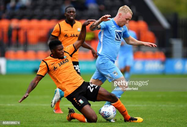 Luke Coulson of Barnet and Jack Grimmer of Coventry City in action during the Sky Bet League Two match between Barnet and Coventry City at The Hive...