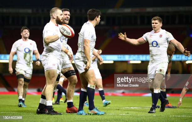 Luke Cowan-Dickie and Owen Farrell of England congratulate Ben Youngs of England after he scores their side's second try during the Guinness Six...