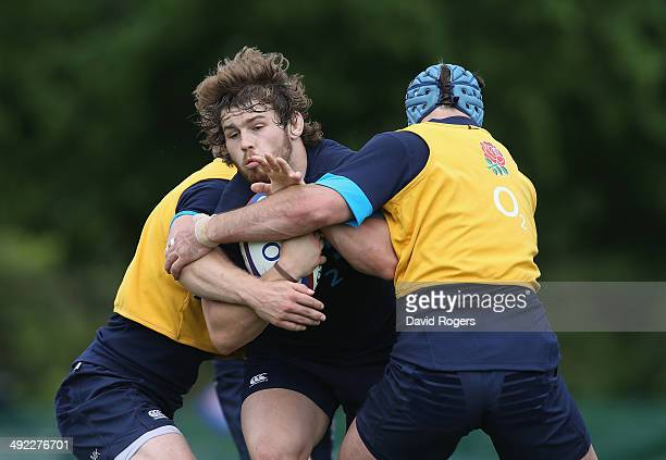 Luke CowanDickie is tackled during the England training session held at the Lensbury Club on May 19 2014 in Teddington England