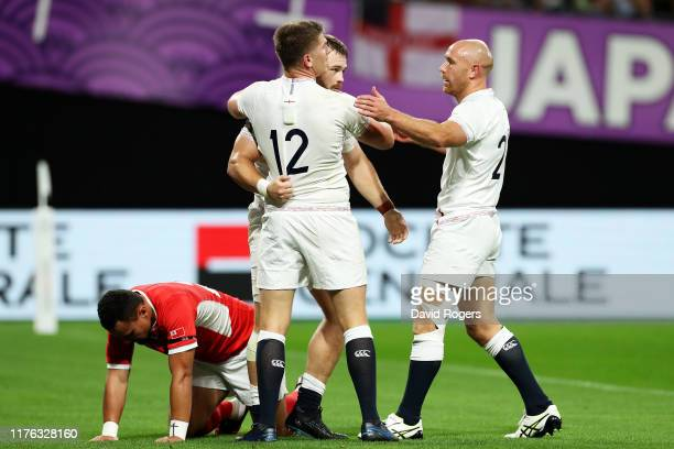 Luke Cowan-Dickie of England is congratulated by Owen Farrell and Willi Heinz after scoring his side's fourth try during the Rugby World Cup 2019...