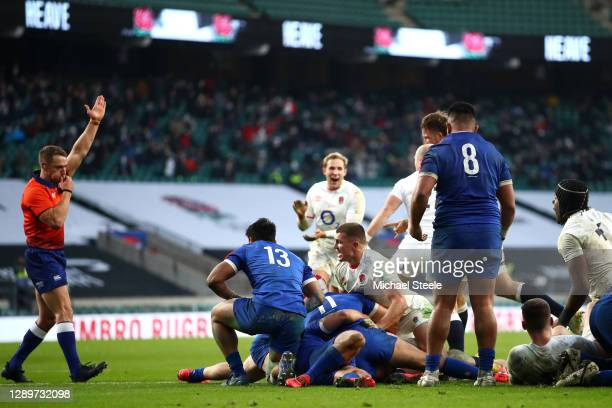 Luke Cowan-Dickie of England scores their sides first try to go to extra time as Henry Slade of England celebrates during the Autumn Nations Cup...