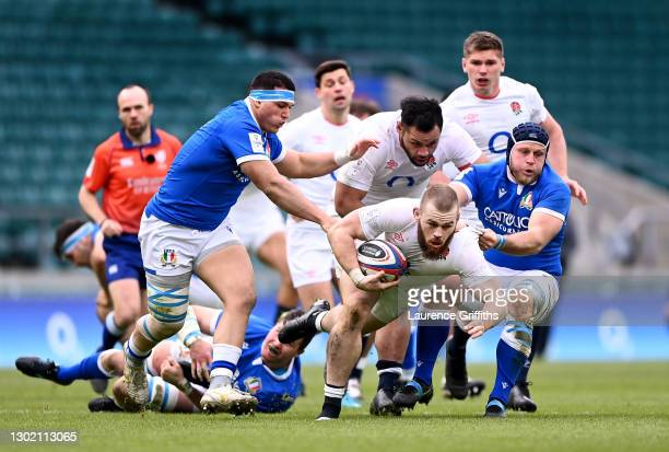 Luke Cowan-Dickie of Englands tackled by Luca Bigi of Italy during the Guinness Six Nations match between England and Italy at Twickenham Stadium on...
