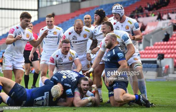 Luke Cowan-Dickie of Exeter Chiefs and his team mates celebrate after he scores a try during the Gallagher Premiership Rugby match between Sale...