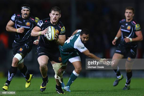 Luke CowanDickie of Exeter Chiefs bursts clear of Telusa Veainu of Leicester Tigers during the Aviva Premiership match between Exeter Chiefs and...