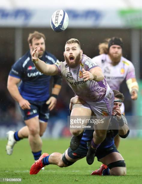 Luke CowanDickie of Exeter Chiefs drops the ball as he is tackled by Tom Curry of Sale Sharks during the Heineken Champions Cup Round 4 match between...
