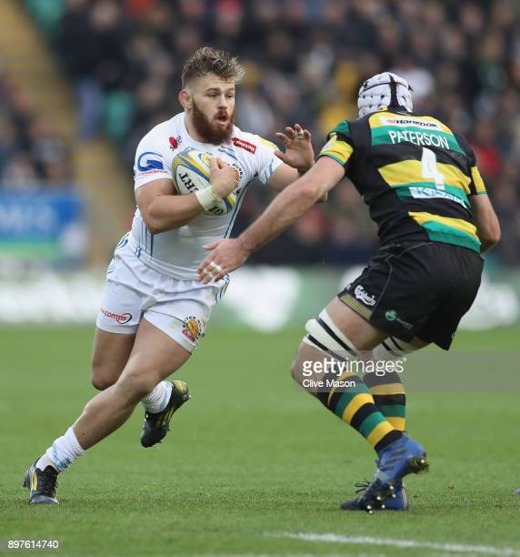 Luke CowanDickie of Exeter Chiefs evades a tackle from Michael Paterson of Northampton Saints during the Aviva Premiership match between Northampton...