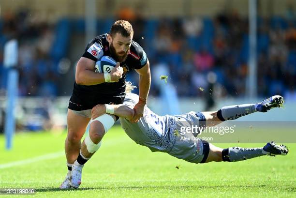 Luke Cowan-Dickie of Exeter Chiefs is tackled by Faf de Klerk of Sale Sharks during the Gallagher Premiership Rugby match between Exeter Chiefs and...
