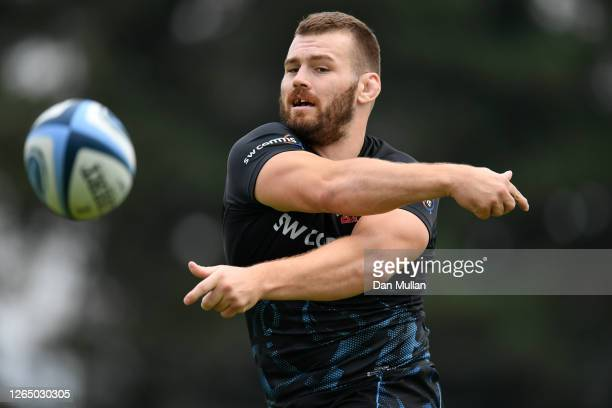 Luke Cowan-Dickie of Exeter Chiefs releases a pass during a training session ahead of the return of Premiership Rugby at Sandy Park on August 10,...