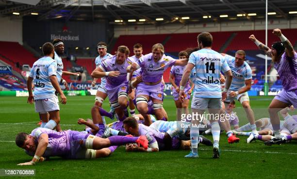 Luke Cowan-Dickie of Exeter Chiefs scores his sides first try as his teammates celebrate during the Heineken Champions Cup Final match between Exeter...