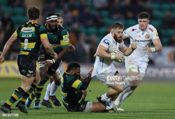 Luke CowanDickie of Exeter is held by Jamal FordRobinson during the Aviva Premiership match between Northampton Saints and Exeter Chiefs at...
