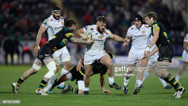 Luke CowanDickie of Exeter is held by Teimana Harrison during the Aviva Premiership match between Northampton Saints and Exeter Chiefs at Franklin's...