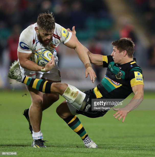 Luke CowanDickie of Exeter is held Piers Francis during the Aviva Premiership match between Northampton Saints and Exeter Chiefs at Franklin's...