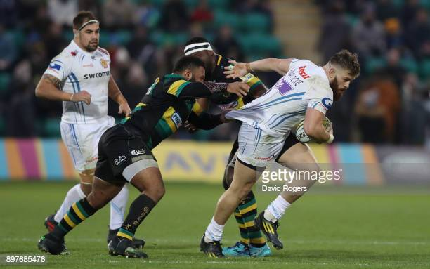 Luke CowanDickie of Exeter is tackled by Jamal FordRobinson during the Aviva Premiership match between Northampton Saints and Exeter Chiefs at...