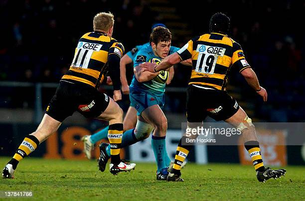 Luke CowanDickie of Exeter runs at Charlie Ingall and Mike Powell of Wasps during the LV= Cup match between London Wasps and Exeter Chiefs at Adams...