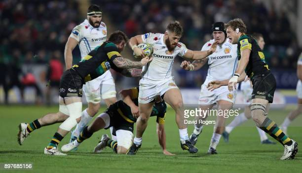Luke CowanDickie of Exeter takes on Teimana Harrison and Jamie Gibson during the Aviva Premiership match between Northampton Saints and Exeter Chiefs...