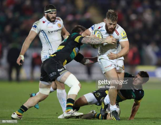 Luke CowanDickie of Exeter takes on Teimana Harrison and Piers Francis during the Aviva Premiership match between Northampton Saints and Exeter...