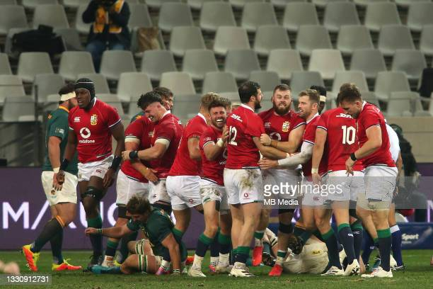 Luke Cowan-Dickie of the British & Irish Lions is congratulated after scoring a try during the 1st test at Cape Town Stadium on July 24, 2021 in Cape...