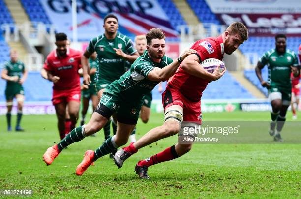 Luke Crosbie of Edinburgh breaks past Ben Ransom of London Irish to score a try during the European Rugby Challenge Cup match between London Irish...