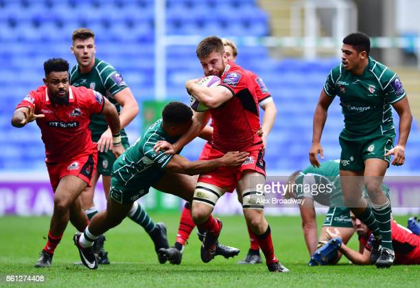 Luke Crosbie of Edinburgh in action against Ben Loader of London Irish during the European Rugby Challenge Cup match between London Irish and...