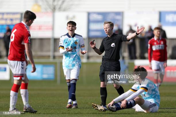 Luke Cundle of Wolverhampton Wanderers reacts as match referee Thomas Parsons awards a free kick to Wolves after Owen Hesketh of Wolverhampton...