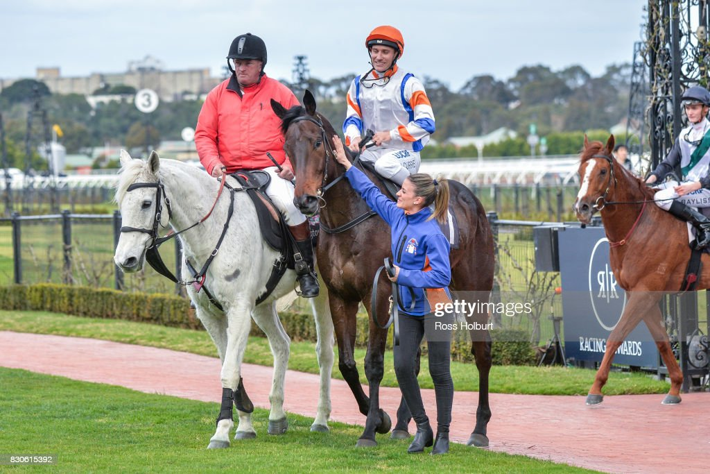 Luke Currie returns to the mounting yard aboard Hey Doc after winning the Aurie's Star Handicap at Flemington Racecourse on August 12, 2017 in Flemington, Australia.