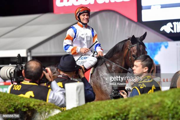 Luke Currie returns to the mounting yard aboard Hey Doc after winning the Ladbrokes Manikato Stakes at Moonee Valley Racecourse on October 27 2017 in...