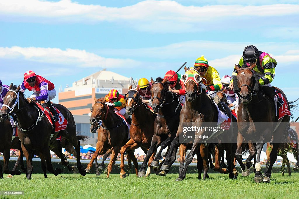 Luke Currie riding Suavito defeats Glen Boss riding Lucky Hussler in Race 7, the C.F.Orr Stakes during Melbourne Racing at Caulfield Racecourse on February 13, 2016 in Melbourne, Australia.