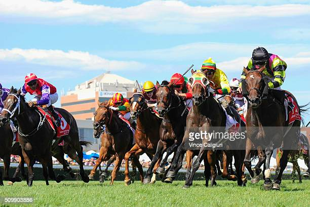 Luke Currie riding Suavito defeats Glen Boss riding Lucky Hussler in Race 7 the CFOrr Stakes during Melbourne Racing at Caulfield Racecourse on...