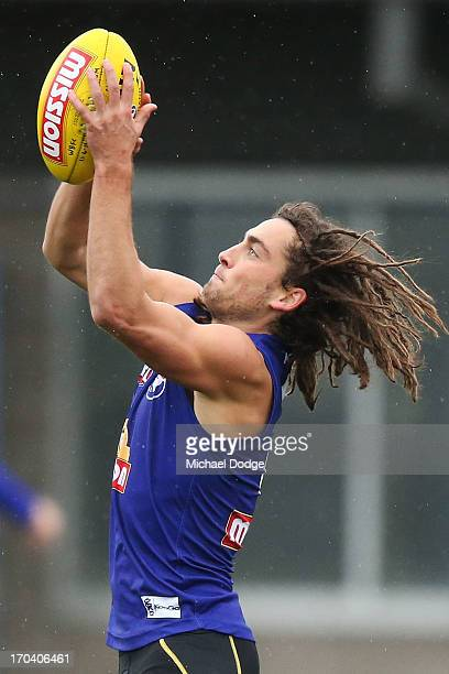 Luke Dahlhaus marks the ball during a Western Bulldogs AFL media/training session at Whitten Oval on June 13 2013 in Melbourne Australia
