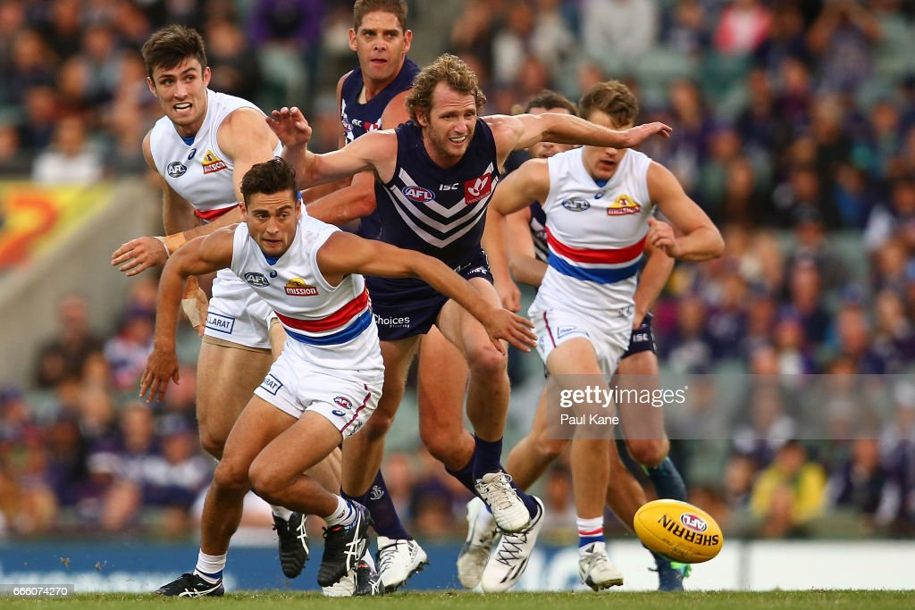 Luke Dahlhaus of the Bulldogs and David Mundy of the Dockers contest for the ball during the round three AFL match between the Fremantle Dockers and the Western Bulldogs at Domain Stadium on April 8, 2017 in Perth, Australia.