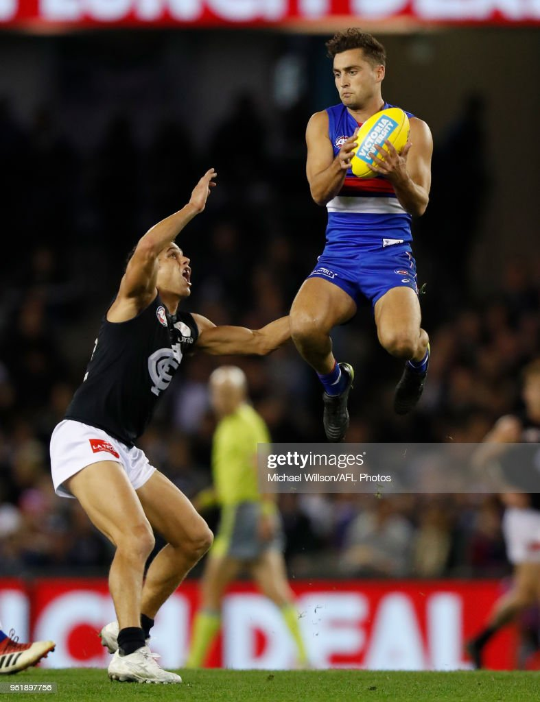 Luke Dahlhaus of the Bulldogs and Ed Curnow of the Blues during the 2018 AFL round six match between the Western Bulldogs and the Carlton Blues at Etihad Stadium on April 27, 2018 in Melbourne, Australia.