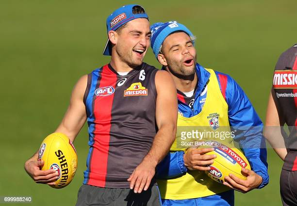 Luke Dahlhaus of the Bulldogs and Jason Johannisen of the Bulldogs laugh during a Western Bulldogs AFL training session at Whitten Oval on June 23,...
