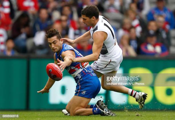 Luke Dahlhaus of the Bulldogs and Leigh Montagna of the Saints compete for the ball during the 2017 AFL round 10 match between the Western Bulldogs...