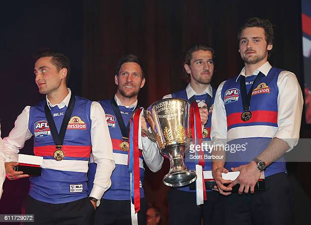 Luke Dahlhaus of the Bulldogs and Marcus Bontempelli of the Bulldogs on stage during the Western Bulldogs 2016 AFL Premiership Cup celebrations after...